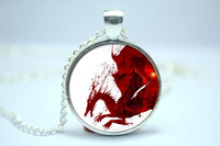 Handmade Dragon Age Origins inspired glass cabochon dome pendant