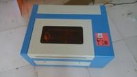 3040 / CO2 laser cutting and engraving machine printer 220V / 100V 40W laser engraved printing red light positioning er