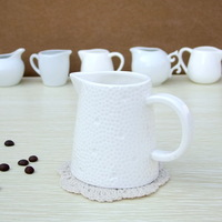 Embossed single fashion ceramic milk cup milk pot proportionating cup creamer cup coffee equipment