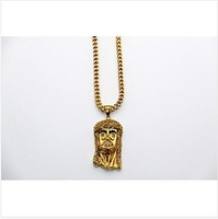 Yellow gold round cut g color jesus piece