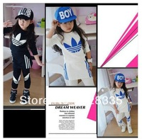 The children set 2014 new children suit wholesale 5 girls group long sleeved T shirt + culotte skirt 2 piece set free shipping
