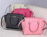 handbag cross grain cowhide smiling bat hand bag rivet slanting across packages