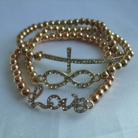 Hot sale. Fashion Crystal CROSS INFINITY LOVE bead stretch bracelet Bracelet set Wholesale/Retailer