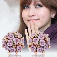 """Ceramic flower blossoms """"delicate earrings"""