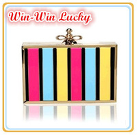 New Women's PU Leather Handbag. Bright Striped Alloy Frame Hard Case Evening Bag. European And American Fashion Clutches
