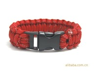 2014 the latest outdoor camping survival bracelet steel bright red + reflective umbrella rope woven bracelet handmade
