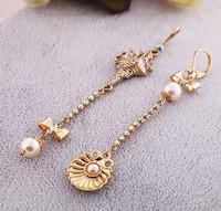 Free shipping 2014 new fashion jewelry punk bow female ocean pearl shell asymmetrical long bow hoop earring clip earcuff women