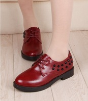 2014 spring lacing casual shoes rivets martin shoes flat heel round toe shoes