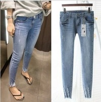 Free shipping new 2014 Korean version burr hole pattern caught pants female feet pencil jeans stretch thin pants women jeans