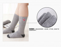 Wearing Grey Cotton Electric Heating Socks Portable High Power Battery Supported Warm Socks For Man Or Women