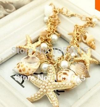 Korean version of the lovely pearl sea shell double star chain bracelet gold statement Bracelets&Bangles fresh ocean beach B-023(China (Mainland))