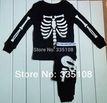 Dro shipping Human skeleton Glow in the Night Kids Pajamas baby sleepwear Long sleeves pajamas boy clothing sets Halloween gifts(China (Mainland))