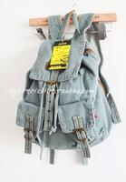 Classic fashion retro pocket denim finishing double-shoulder casual book backpack water wash blue