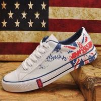 Free shipping Men low recreational canvas shoes sneakers graffiti white goose bottom men sneakers