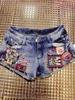 2014 steller's badge sparkling diamond rivet diamond denim shorts boot cut jeans female