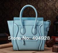 3308 3307 The emperor blue fluorescence 2014 new smile face handbag original leather purse wholesale and retail