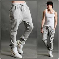 Middlelowlevel spring pants ultralarge pants male taper skinny pants male black pants hiphop jeans
