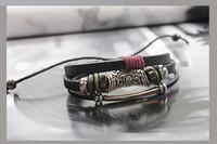 Ms. Hollow Tone Flower Retro Fashion Leather Beaded Bracelet