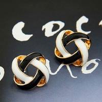Korean trinkets simple and generous personality wild retro black and white earrings earrings Openwork