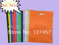 Sell stock 100pcs 25x30cm punch handle non woven shopping bag