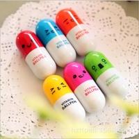 Hot cute capsule shape ballpoint pen for children prize gift pen cute smile face writing pen advertise ballpen