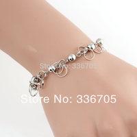 2014New Arrival Free Shipping 10pcs/lot Fashion Lady's10mm Hanging Bell Pattern Metallic White Bracelet25327#
