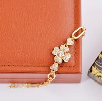 Min order is $10(mix order) vintage exquisite sparkling rhinestone flower gold plated bracelet chains bracelets for women