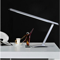 The long arm of metallic minimalist touch dimmer LED eye work study student learning office desk lamp