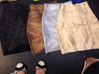 Free shipping 2014 new ladies skirts cut out gold foil silver black hl bandage skirts skirts wholesale and dropshipping