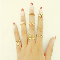 2014 New Arrive 7Pcs/Set Fashion Design Cute Eye Bowknot Crown Rhinestone Joint Rings Freeshipping&Wholesale