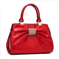The new fashion Women genuine leather handbag Patent leather bowknot rhinestone female bag vintage bag female bag for women