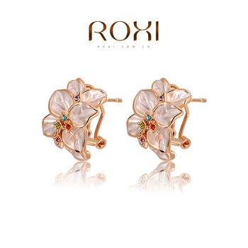 Roxi женские серьги-гвоздики ручной работы, выполнены в виде цветов, изготовлены из красного золота (позолота), с трех разовым золотым напылением, серьги украшены цветными австрийскими кристаллами