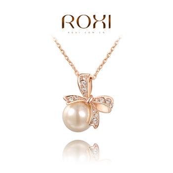 Roxi женское ожерелье-цепочка ручной работы,изготовленое из розового золота с трех разовым зототым напылением,украшено подвеской в виде бантика покрытого австрийскими кристаллами и белым жемчугом, 100% качество