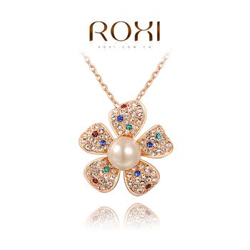 Roxi очаровательное женское ожерелье-цепочка ручной работы,изготовленое из розового золота с трех разовым зототым напылением,украшено подвеской в виде цветка покрытого разноцветными австрийскими кристаллами и жемчугом.