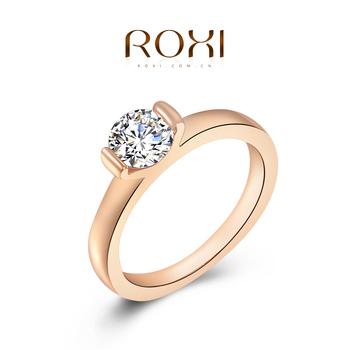 Roxi изящное женское кольцо,ручная работа, изготовлено из розового золота с трех разовым золотым напылением, украшено 1-м камнем из швейцарского циркония, подойдет для помолвки или подарка девушке, размеры 5-8