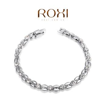 """Roxi стильный женский браслет ручной работы """"Колос"""", изготовлен из белого золота с трех разовым золотым напылением (позолота), плитение в виде колоса пшеницы, украшен яркими австрийскими кристаллами"""