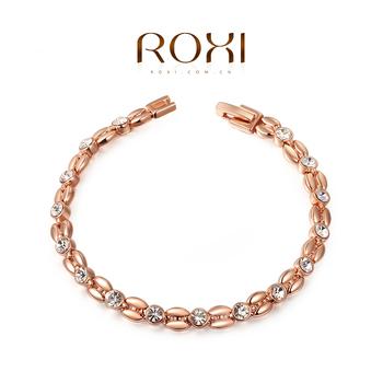 Roxi женский шикарный браслет ручной работы, изготовлен из розового золота с трех разовым золотым напылением, плитение напоминает по форме колос пшеницы, украшен австрийскими кристаллами, длина браслета 20см