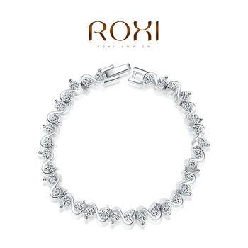 Roxi стильный женский браслет ручной работы, изготовлен из белого золота с трех разовым золотым напылением (позолота), плитение в виде зикзака, украшен встрийскими кристаллами, шикарный дизайн