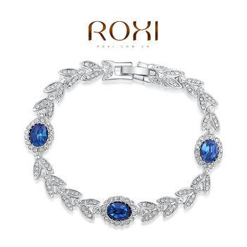 Roxi стильный женский браслет ручной работы, изготовлен из белого золота с трех разовым золотым напылением (позолота), украшен яркими австрийскими кристаллами и синеми камнями, 100% качество