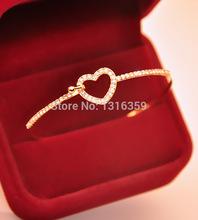 S007 Mix wholesale.free shipping 2014 New Arrival!Fashion Simple Rhinestone hollow heart bracelet Bangle Jewelry for women(China (Mainland))