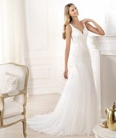 draped V-neck and draping at the back  Bodice mother-of-pearl vintage gold embroidery and skirt with godets wedding dress