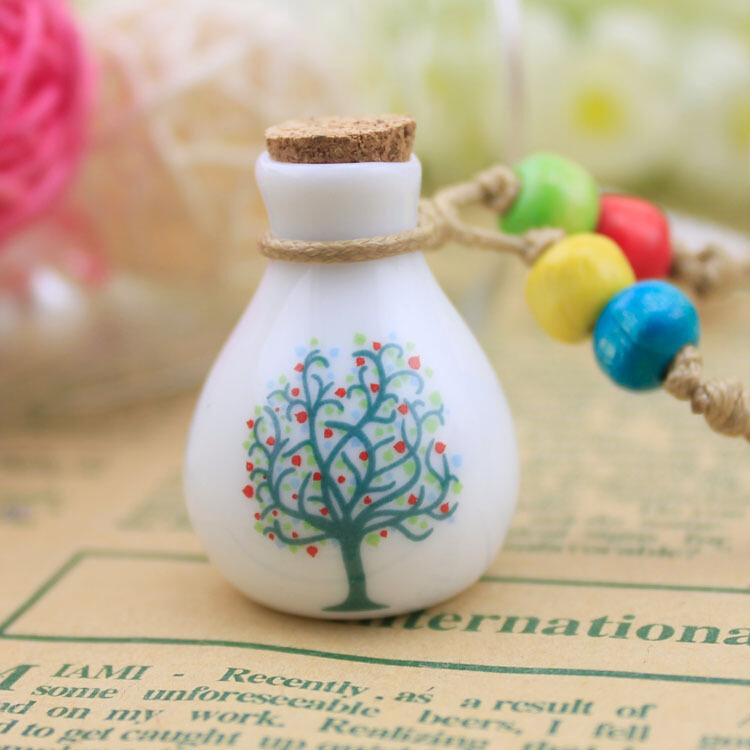 Free shipping 2014 Japan and South Korea jewelry wholesale perfume bottle women happy tree long necklace(China (Mainland))