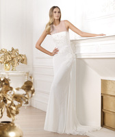 embroidery in mother-of-pearl and silver that cascades from the shoulder down to the sides to the skirt  women wedding dress 51