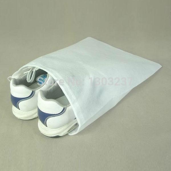 10pcs/lot Wholesale Non-Woven White Shoe Organizers Storage Bag Pack For Travel Dustproof 1pcs Free Shipping(China (Mainland))