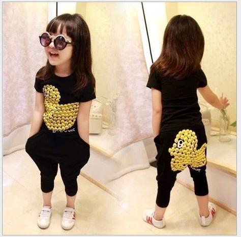Free shipping Children's clothing summer new Korean version cartoon duck girls short sleeve tops + black harem pants two suit(China (Mainland))
