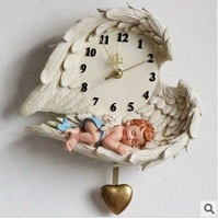 Fashion swing wall clock mute Little angel  clock resin wall clock resin clock free shipping