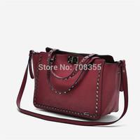 Fashion motorcycle paragraph rivet decoration one shoulder handbag messenger bag 0.59kg