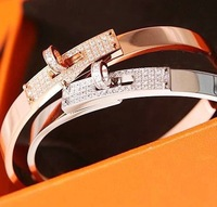 Fashion18k rose gold Plated platinum color swiss drill Crystal rotating button rolling titanium steel bangle bracelet for women