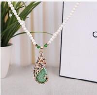 Free shipping the new fashion magazine Semi-precious stones inlaid The peacock pendant alloy beads