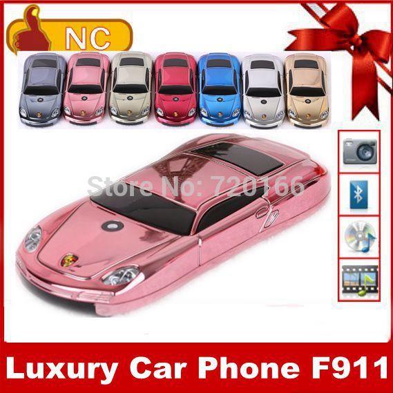 Free shipping luxury mini car mobile phone F977 977 F11 support car lamp Russian keyboard French Spanish unlocked dual SIM card(China (Mainland))